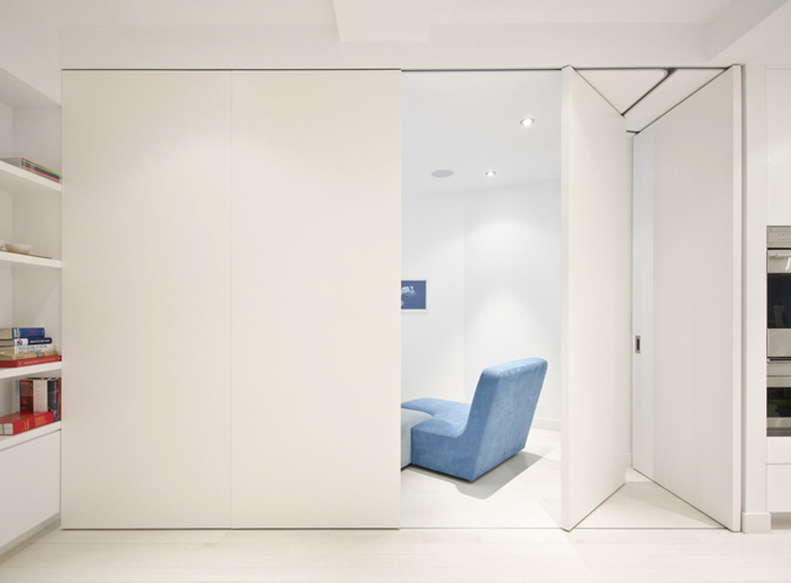 As they open, they fold and stack flush. There was no room for a pocket door since the oven is directly next to the partitioned-off space.  University Place Apartment by Diana Budds from Novel Space-Saving Designs