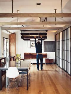When not in use as the headboard, the large redwood slab folds down to become a desk.