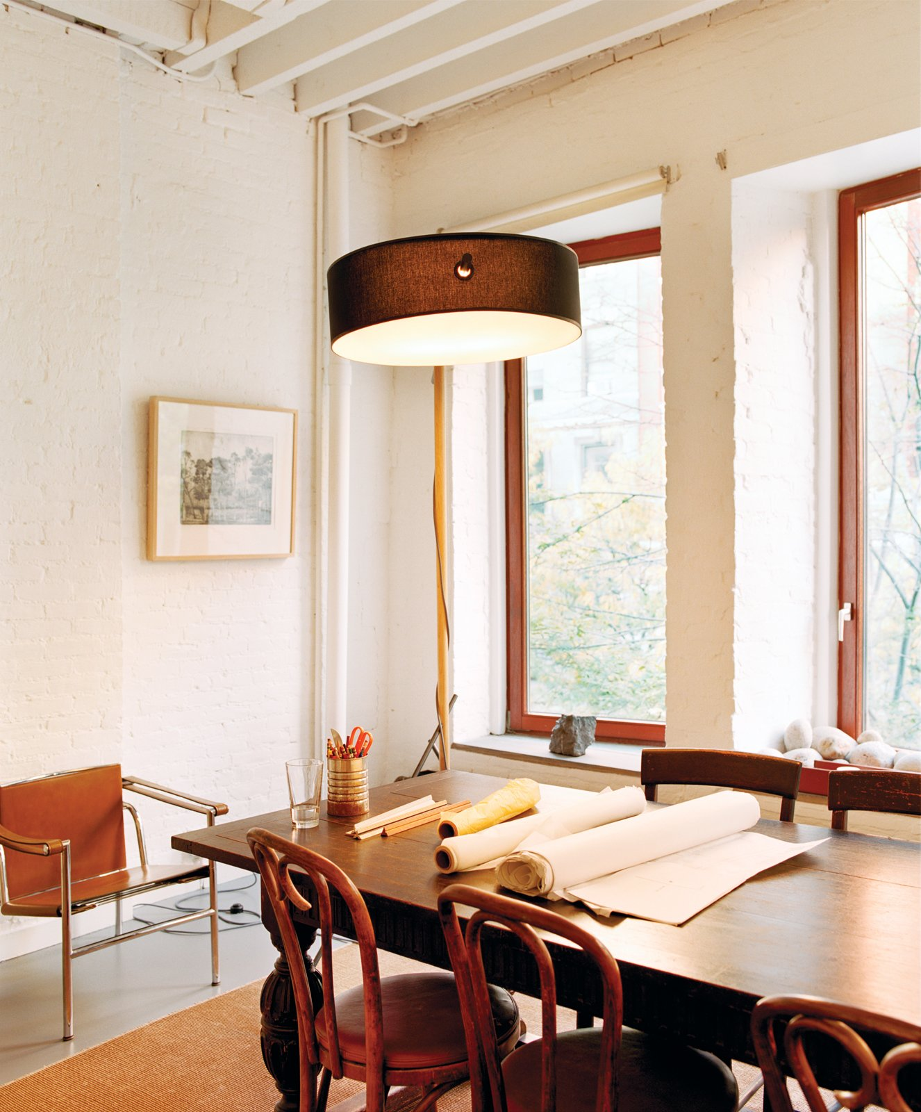 Dining Room, Chair, Pendant Lighting, and Table Ryall's only so-called extravagances in the inexpensive renovation were the weather- and sound-resistant windows and central air-conditioning system.  Photo 2 of 3 in Manhattan