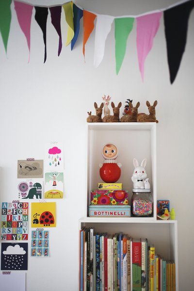 While she was pregnant and on maternity leave, Susanna tackled creative D.I.Y. projects to decorate Varpu's room, including stitching these festive cotton flag banners.