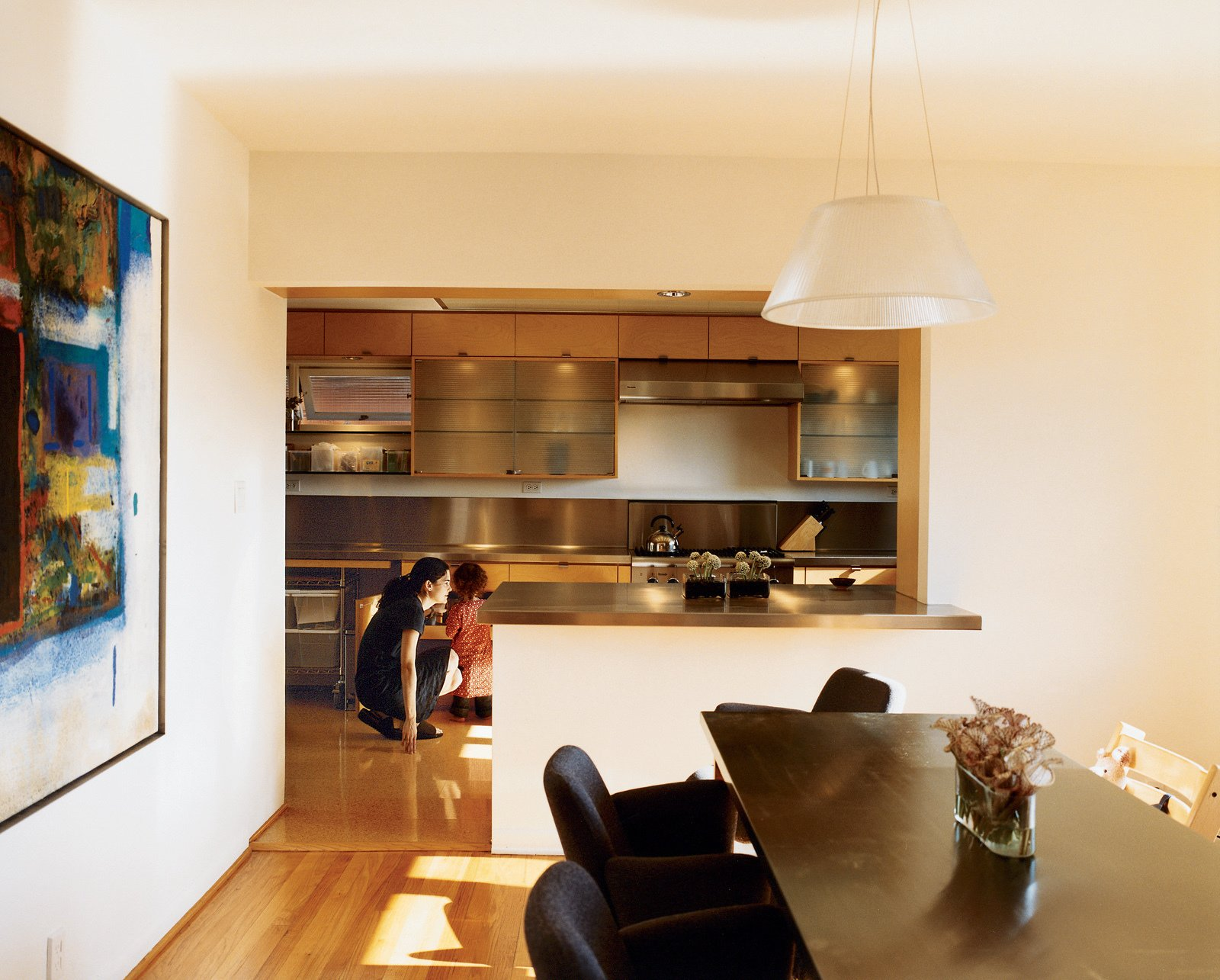 Hachigian and daughter Sosi in the renovated kitchen, which opens up to an outdoor dining terrace. The dining table was reconditioned from a language lab, its top wrapped in stainless steel. Dining chairs are by Kartell.  Photo 5 of 12 in Way Out West