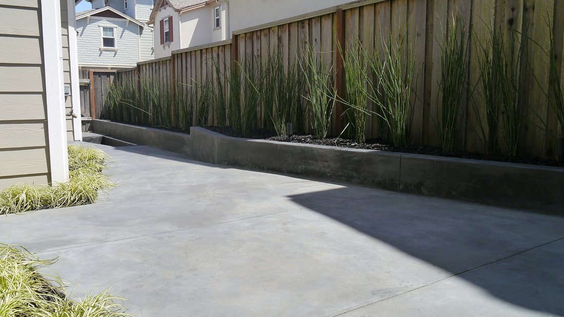 """""""I think there's plenty of missed potential in small compact spaces like these,"""" Lee says. I see it in my neighborhood and other places in publication. People tend to think a small space is a small space and don't try to do very much with it.  Concrete from A Design-Minded Solution to a Narrow Landscape"""