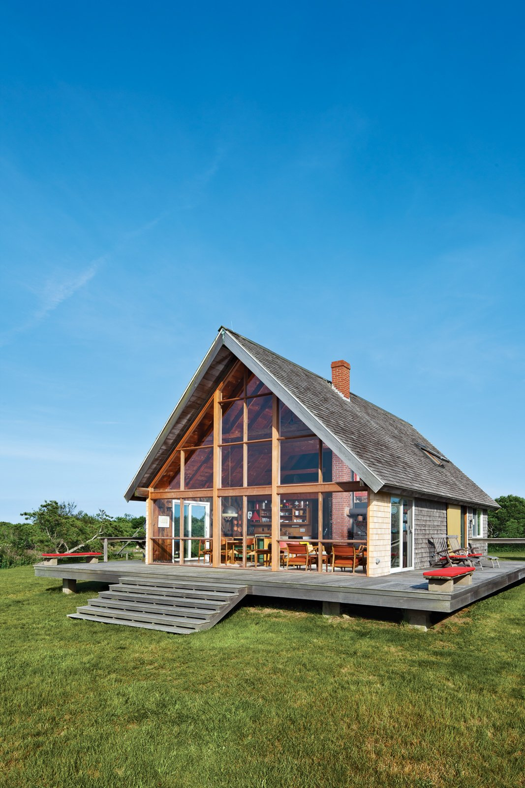 jens risom block island modern prefab vacation home a frame exterior wood deck