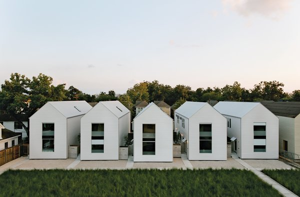 """The series of pitched white buildings was inspired by the work of architect Hugh Newell Jacobsen. """"The shell of the house is a very simple form,"""" says Matthew Ford, """"no turns or intersecting roof sections. This allowed me to use solid but inexpensive framing and roofing crews. We are always looking for the point where simplicity and luxury meet."""""""