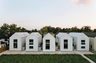 "The series of pitched white buildings was inspired by the work of architect Hugh Newell Jacobsen. ""The shell of the house is a very simple form,"" says Matthew Ford, ""no turns or intersecting roof sections. This allowed me to use solid but inexpensive framing and roofing crews. We are always looking for the point where simplicity and luxury meet."""