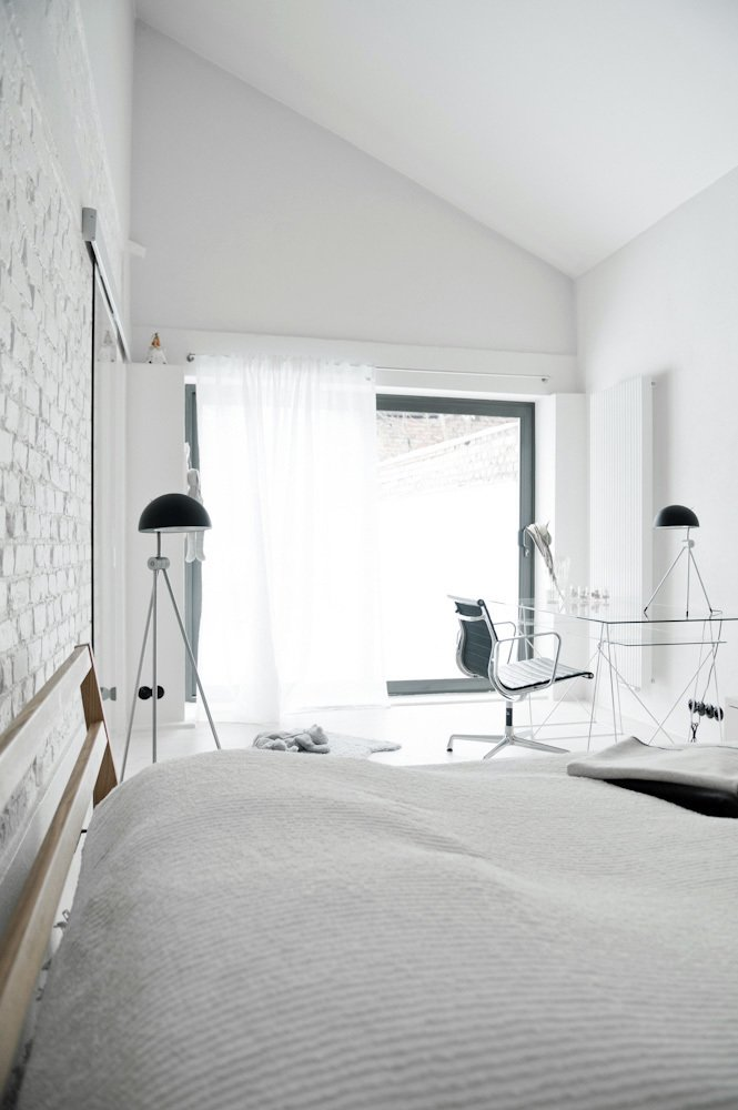 Bedroom, Bed, Floor Lighting, and Table Lighting For the bedroom, the designer selected a bed by Muji and floor lamps by Lightyears.  Photo 9 of 10 in A Run-Down Farmhouse Becomes a Sleek Modern Retreat