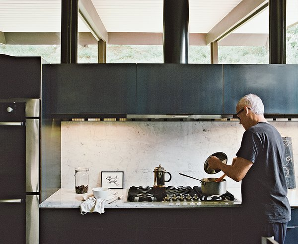 A Carrara marble backsplash adds cool contrast and a sense of drama when set against the custom oiled-steel black cabinetry in the renovation of the kitchen in this A. Quincy Jones home in Los Angeles.