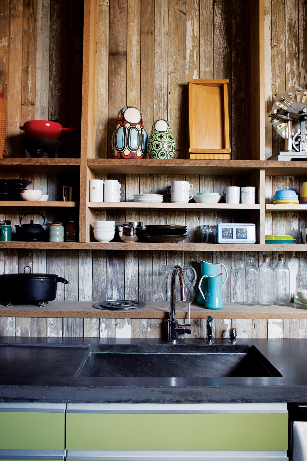 """Kitchen and Wood Cabinet With its reclaimed-wood cladding, the kitchen is a rough-and-ready backdrop for the family's tableware.  Search """"jenni konners hollywood pad ready its close"""" from Play's the Thing"""