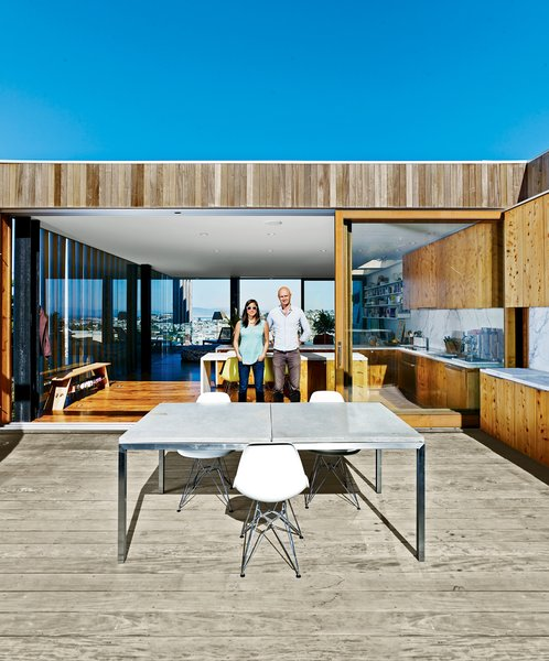 Mechanical engineer Jan Moolsintong and industrial designer Peter Russell-Clarke get epic views of San Francisco from their 1,800-square-foot house overlooking the Mission District. On warm nights, they eat dinner perched on Eiffel side chairs by Charles and Ray Eames around a table from Room & Board. The distinctive facade has operable porthole windows and a slatted garage door custom-built by Raimundo Ferreira.