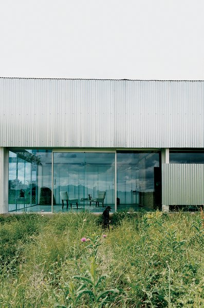 The front entrance of the Farley Studio presents a clean, minimalist space—a stark contrast to the colorful clutter of the painting studio hidden behind corrugated-metal walls at the back of the house.
