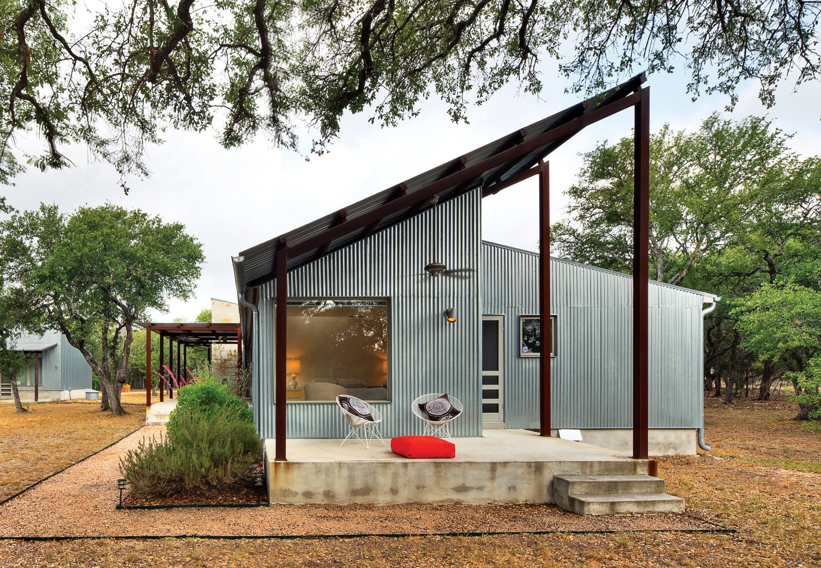 Exterior, Metal Siding Material, Metal Roof Material, and House Building Type For a cost-conscious 2,000-square-foot renovation located 30 minutes outside of Austin, Texas, architect Nick Deaver took a look around for inspiration. He spied galvanized metal cladding on the region's sheds and co-opted the inexpensive, resilient material for his own design.  Best Photos from An Affordable Duplex Transformation in Texas