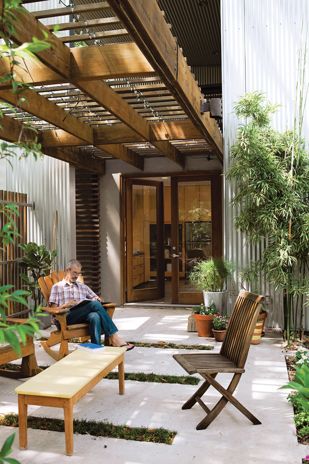 Outdoor, Back Yard, Small Patio, Porch, Deck, and Concrete Patio, Porch, Deck Moreland House  Homes from Rick Moreland Reads a Building