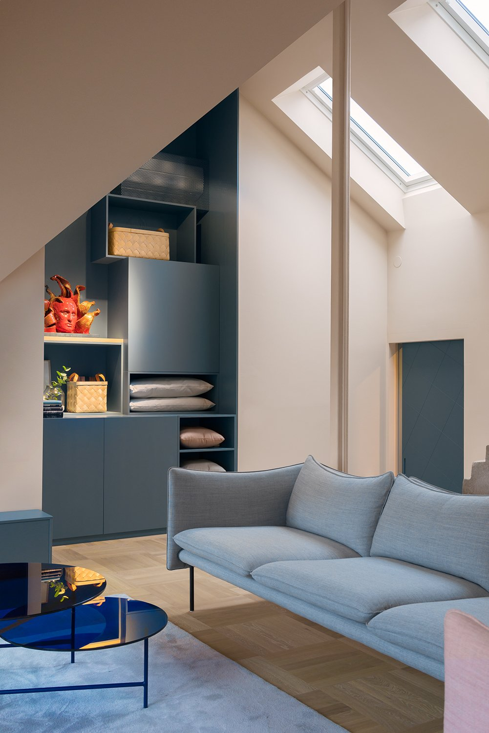 The storage unit continues in the living room, marked by a Tiki sofa by local design company Fogia. NOTE designed the stool as well as the coffee table, which was created for the French brand La Chance as part of a series called Zorro.  Loft from There's Not a Single White Surface in This Comfy Stockholm Loft