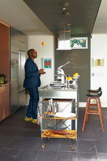 Architect David Anand Peterson designed the custom millwork and shelving in Montague's kitchen. The stainless steel island is by Bulthaup. The stools are vintage and were designed by Erik Buck. Montague was thrilled to spot the same ones   adorning Don Draper's apartment in   the latest season of Mad Men.