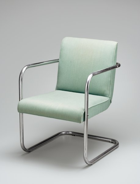 Eero Saarinen   The junior Saarinen's debut as a furniture designer—at age 20—came with a commission for most of the furnishings at Cranbrook's Kingswood Middle School for Girls in Michigan. (His father, Eliel, designed the campus.) His 1930 auditorium armchair, made of tubular chromed steel and wood with light-green woven upholstery, has a cantilevered seat, like Mies van der Rohe's Brno chair from the same year.