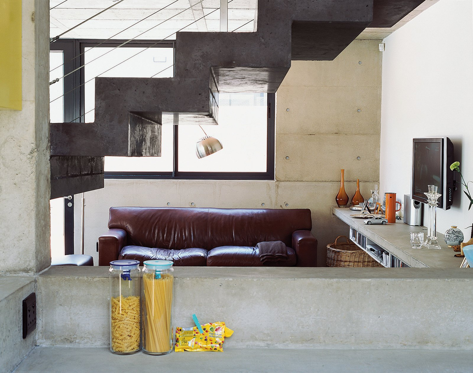 Caryn was thrilled to discover that all her personal details look spectacular when offset against the solemnity of concrete. In profile, the freestanding staircase is the most outstanding design accent.  190+ Best Modern Staircase Ideas from Katz's Cradle