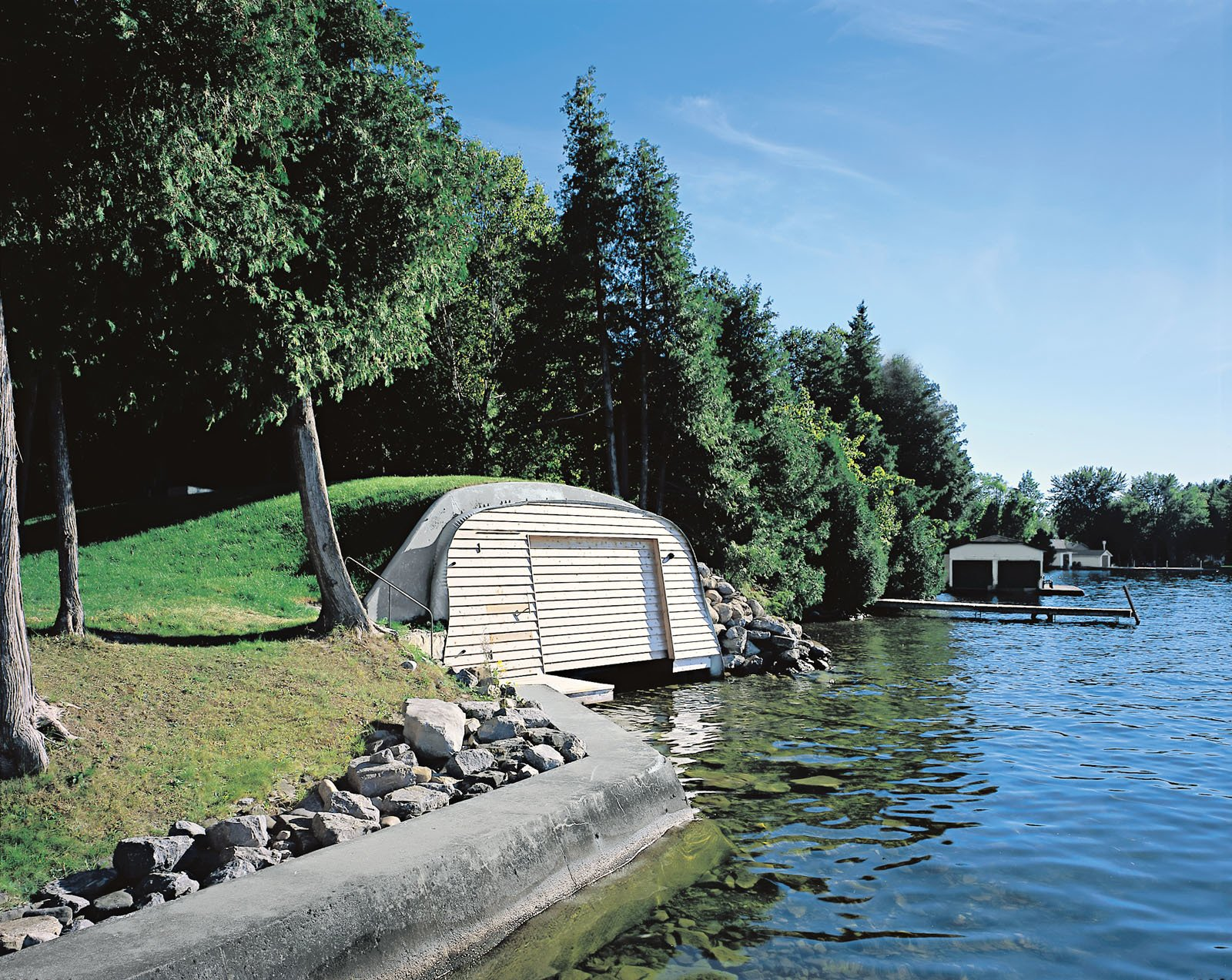View of the boathouse from the lake.  Photo 3 of 3 in About a Boat