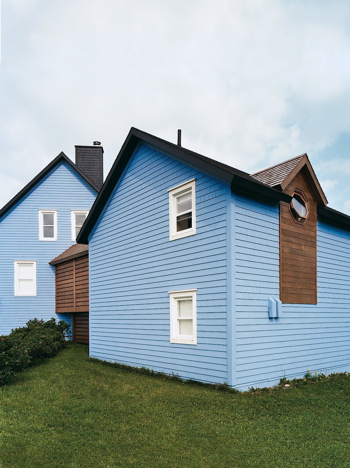 Exterior, House Building Type, Wood Siding Material, and Shingles Roof Material Glimpsed from the outside, it becomes clear how an internal corridor flows through both structures at an uncommon angle.  Colorful and Vibrant Farmhouses by Luke Hopping