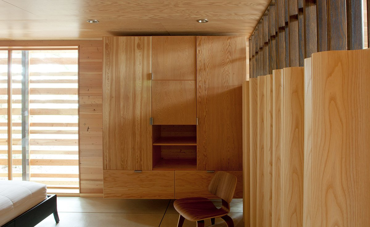 The lower-level sleeping area boasts a plywood wardrobe, Eames LCW, and Eames plywood folding screen.  Ways to Design with Plywood by Kelsey Keith