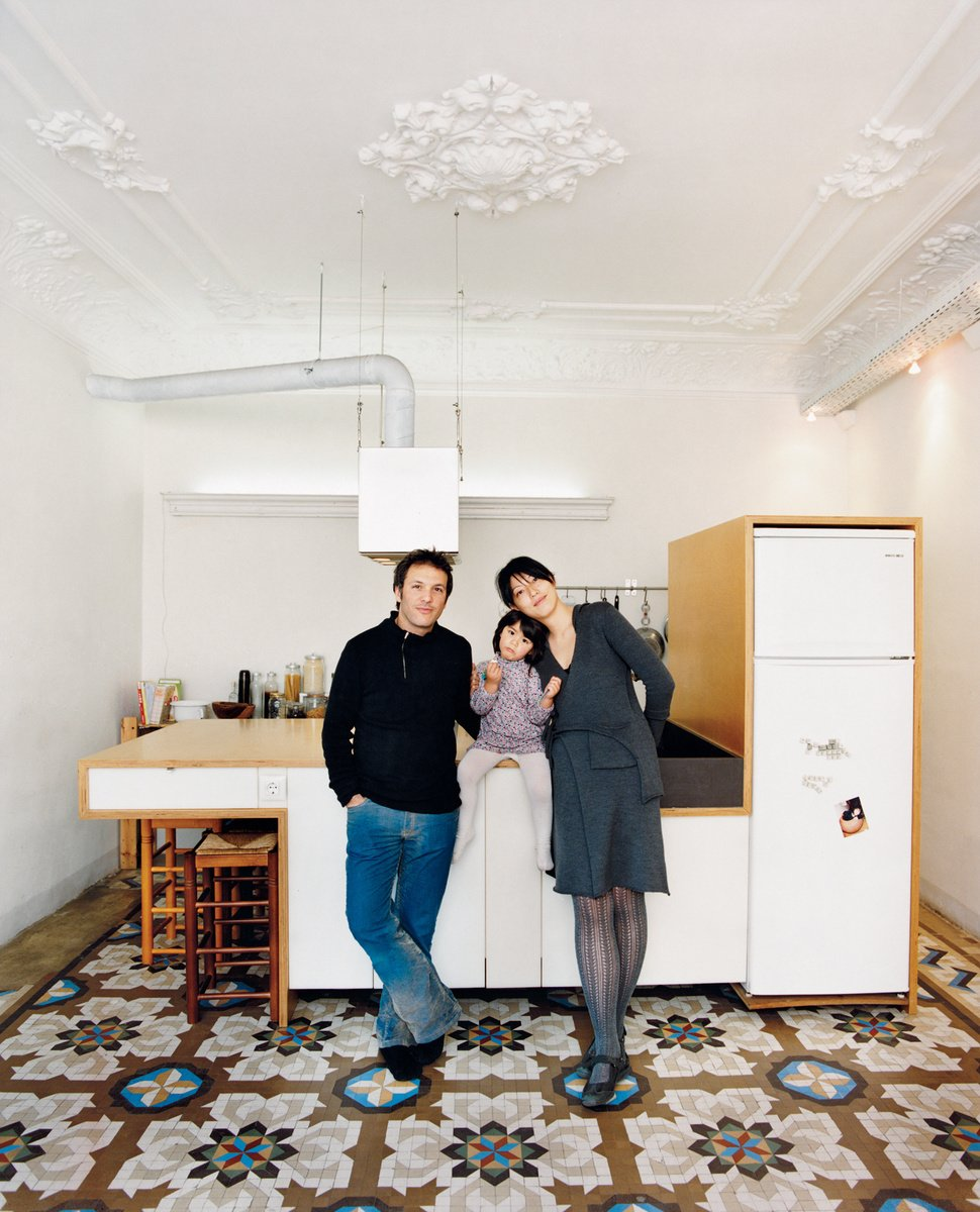 Kitchen, Accent Lighting, Pendant Lighting, and Cement Tile Floor Homeowners Cecilia Tham and Yoel Karaso renovate their home in Barcelona, harmoniously overlapping elements of the old and the new. Photo by: Gunnar Knechtel  Best Photos from Kitchens We Love: Wood