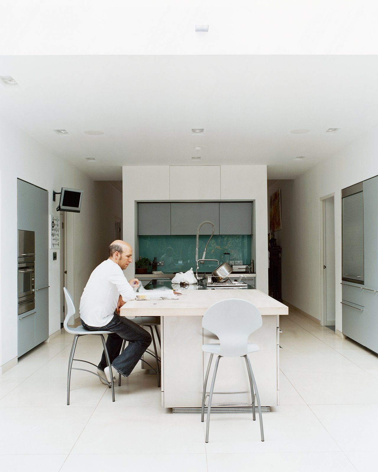 """To avoid formality, Phillips created a different environment for each room. The kitchen, for example, is understated by virtue of its simple cabinetry by Boffi, and its white walls that flow with the rest of the house. """"What we love about living here,"""" says Judith, """"is that it works well with our young family. There is plenty of daylight, all the latest technology, and we don't have to worry about sticky fingers destroying anything.""""  Photo 6 of 10 in Victorian Secrets"""