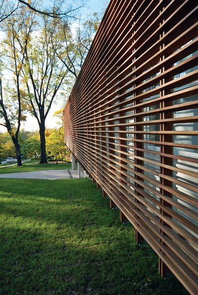 Architect Dan Rockhill tackled a tight budget and a steep slope to build a modern Midwest haven for a family in Lawrence, Kansas, who had just $214,000 to spend on design and construction. His biggest flourish was a slatted exterior screen of Cumaru wood that shields the inexpensive metal siding.