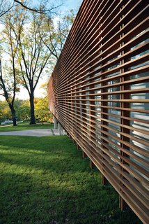 Contemporary Kansas Home with Wood Slatted Exterior Screen