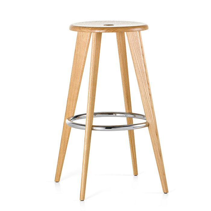 """""""Prouvé's stools are so simple and beautiful,"""" says Robin Standefer and Stephen Alesch of Roman and Williams. """"There is wonderful, earnest detailing, and they have a great mixture of metal and wood—warm on the butt, sturdy on the legs."""" Jean Prouvé's Tabouret Haut, pictured, dates from 1942; Vitra now produces the piece.  Photo 8 of 8 in How to Find the Perfect Modern Bar Stool"""