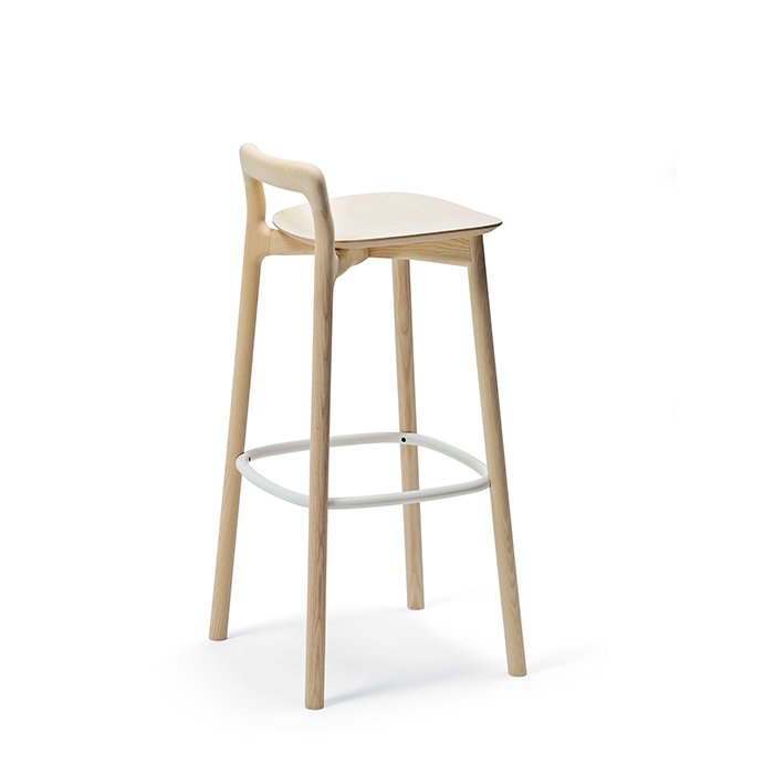 Branca stool by Sam Hecht and Industrial Facility for Mattiazzi, $1,049–$1,069  Introduced at the Milan furniture fair in April 2014, the Branca stool channels the natural beauty of trees. The gently curved seat is angled slightly higher in the front, which helps you feel balanced. The low back gives lumbar support. It's available in natural, white, and black finishes and with a black or white footrest.  Photo 6 of 8 in How to Find the Perfect Modern Bar Stool