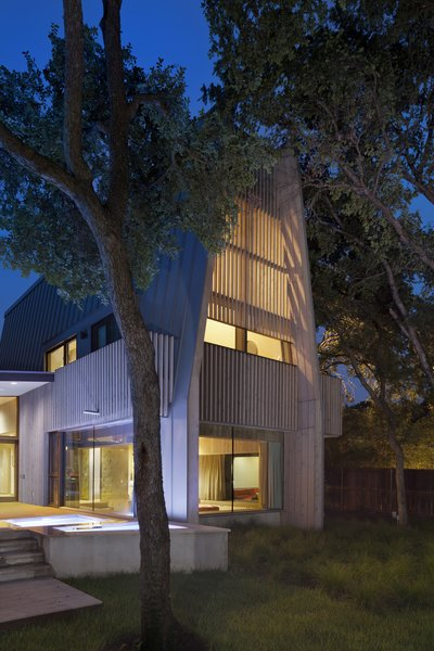 The architects felt that a strong vertical addition would draw extra attention to the original house's strong horizontal character. The tower itself is a reinterpretation of an A-frame from another Strenger house five doors down.