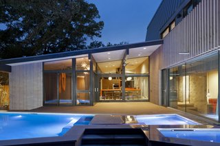 A pool located just outside the dining space and master bedroom echoes the home's angular forms.