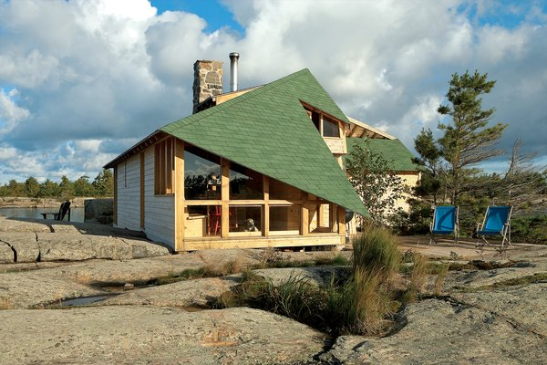 The winglike dips in the roofline situate and hold the house against the region's brutal winds. As the outdoor chairs attest, lifestyles here pass easily between inside and out; a long hike and a good swim are always just steps away
