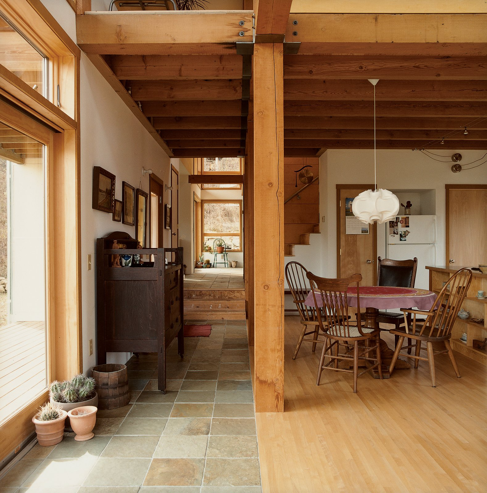 Structural timbers were salvaged from a local industrial building and demarcate the change in flooring surfaces.  Photo 11 of 12 in Labor of Loved Ones
