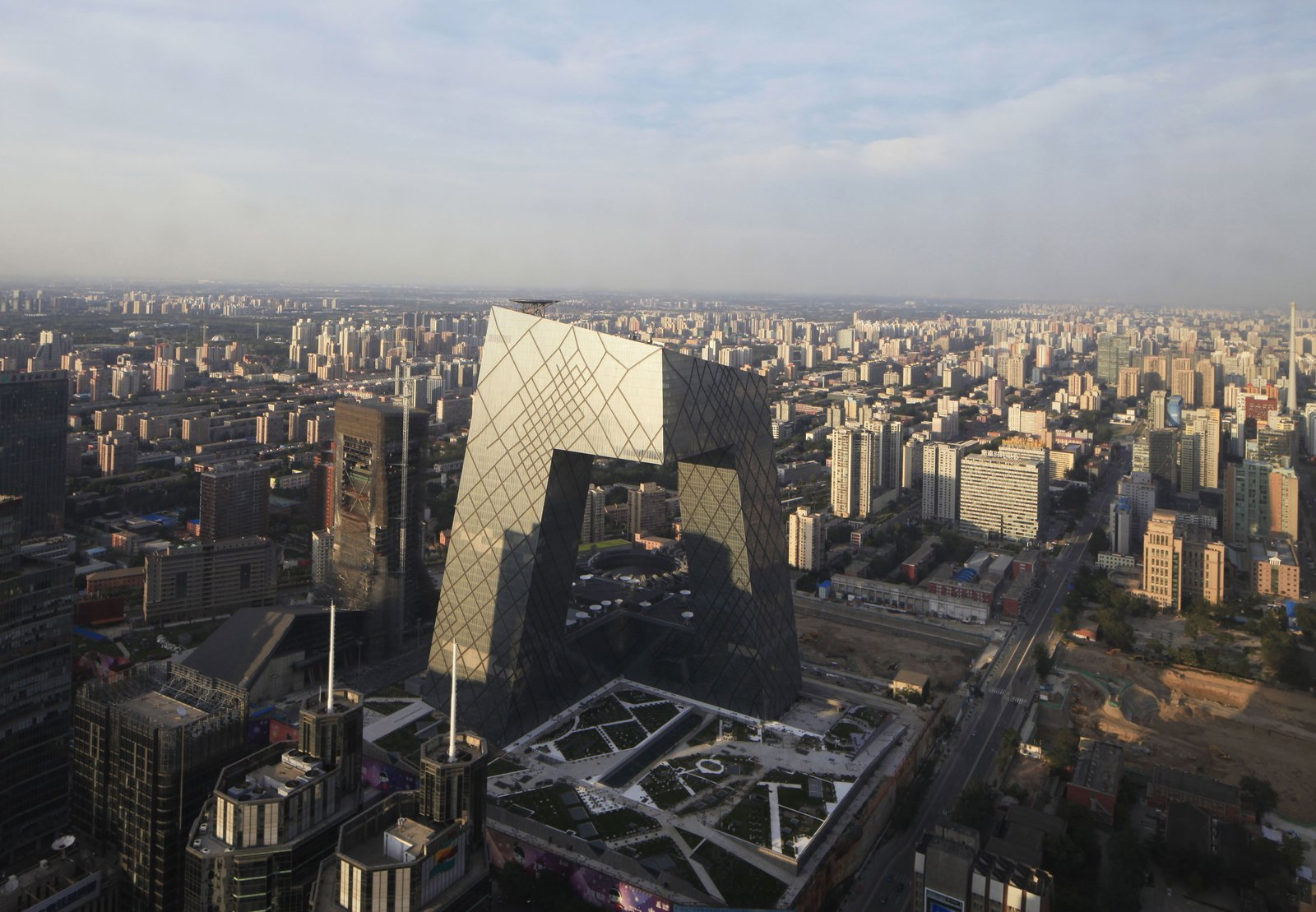 """The CCTV building, the headquarters of China Central Television designed by OMA, in earthquake-prone Beijing. Photo by Iwan Baan.  Photo 1 of 6 in """"Quake"""" Exhibit Explores Intersection of Architecture and Engineering"""