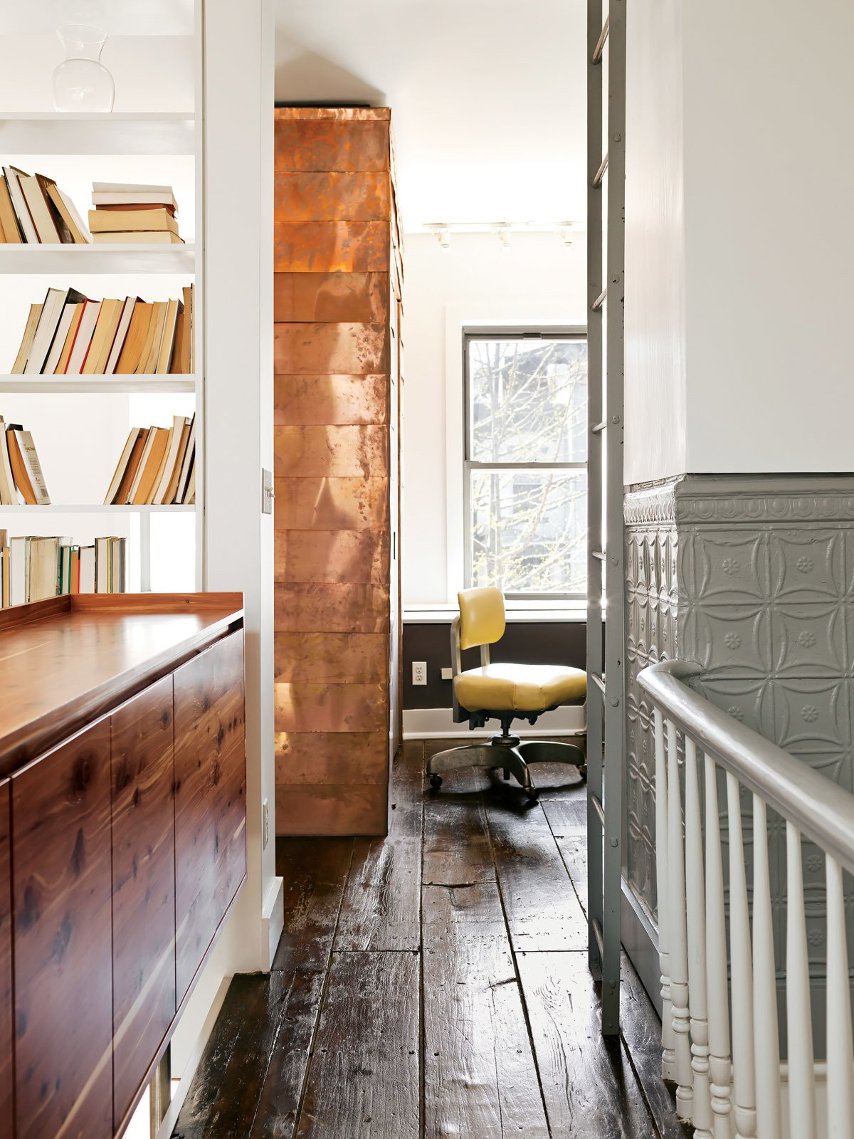 Office, Chair, and Shelves The copper-covered volume extends from the first floor, where it contains coat and shoe storage.  Fall Design Trend: Gold, Brass, and Copper Accents by Megan Hamaker from New Prospects