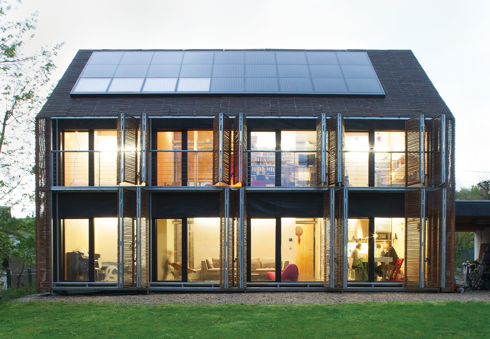 Outdoor, Back Yard, and Grass Among the first Passive Houses in France, this bamboo-clad farmhouse by the Parisian firm Karawitz Architecture only uses a tenth of the energy a conventionally constructed home does. Photo by Nicholas Calcott.  Photos from Passive Acceptance: 7 Energy-Efficient Homes