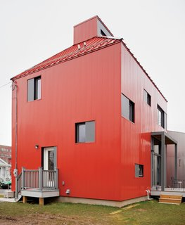 """The TED House by Onion Flats was the result of an international design competition sponsored by Syracuse University and a local non-profit developer. """"The challenge was to design a modestly priced, environmentally thoughtful house on a narrow lot in an urban neighborhood, easily adaptable to other sites in the area, and for a budget of $150,000. Our proposal utilized a compact plan and a high performance envelope to reduce the energy demand by up to 90%,"""" says the firm."""