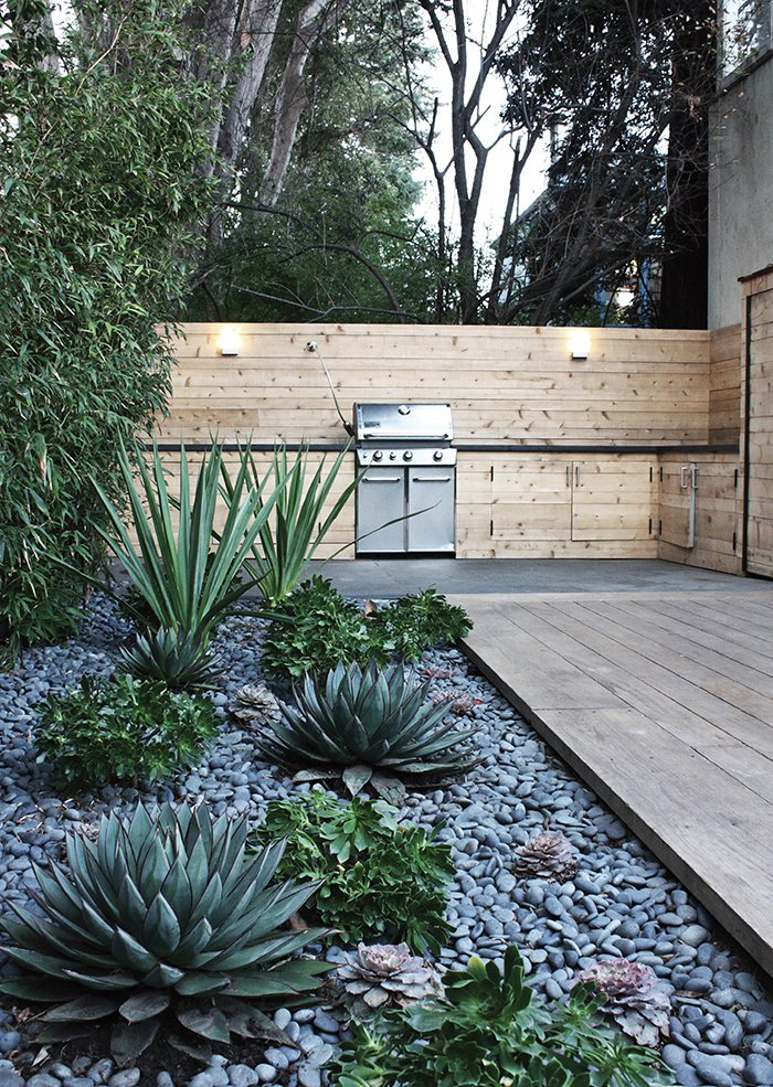 Outdoor, Wood Fences, Wall, Hardscapes, Gardens, and Back Yard Another water-saving project in Menlo Park includes a rock bed with succulents.  Photo 4 of 4 in How to Make Your Garden Water-Free