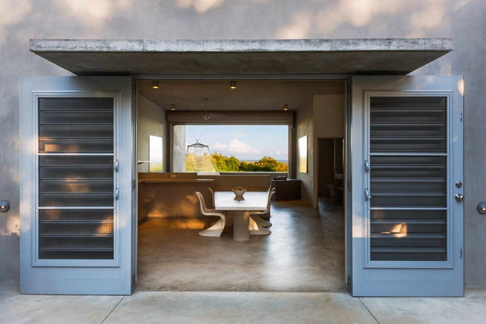 There is a large cistern built into the base of the building, which collects rain water from the roof. Photo by Michael Grimm.  Photo 6 of 9 in Modern Concrete Getaway in Paradise