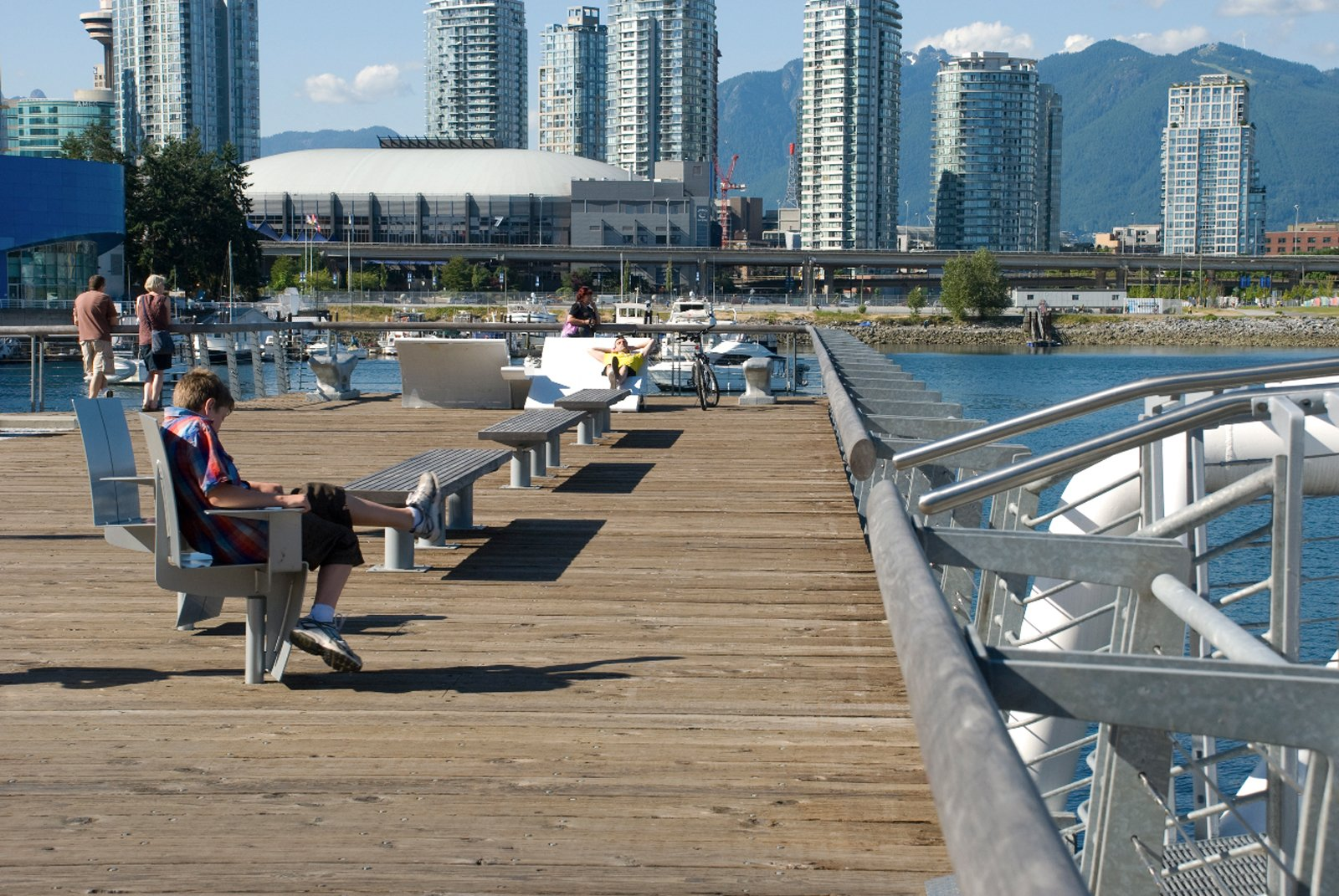 Olympic Village by PWL  A mix of street furniture designed for the Olympic Village in Vancouver offers swiveled chairs (all comforts of home right on the waterfront!) with oversized white loungers. Both get plenty of use by people looking to either relax or take in the urban waterfront sites on the newly designed boardwalk.  Street Furniture Your City Wishes it Had by Tim Newcomb from Great Designs from Vancouver