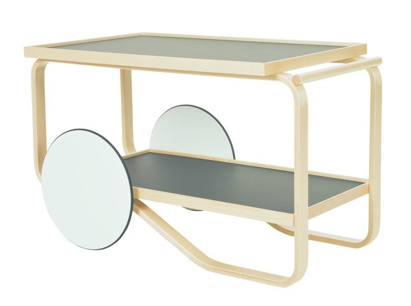 Designed by Alvar Aalto in 1936, the Artek 901 Tea Trolley is a surprisingly contemporary take on traditional bar carts and tea trays. The sculpted, natural lacquered birch frame is paired with two shelves and white lacquered MDF wheels with black rubber rings to provide smooth movement without damaging floors. The trolley is defined by its play of sharp and soft corners, rectangular and round shapes. The result is a well-balanced piece of furniture that can be used in a dining room, living room, or kitchen.   This trolley, along with other Artek designs, is 15% off until October 22, 2015.