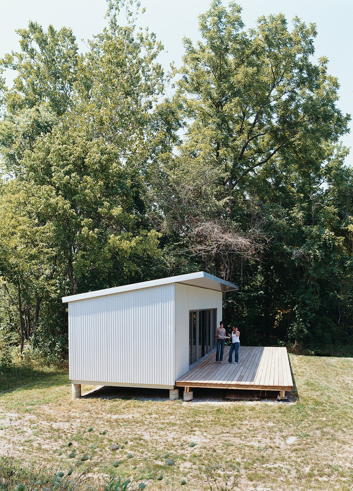 Exterior, Prefab Building Type, and House Building Type Romero and product manager Julie Schaefer at the Base Camp prototype .  Best Photos from All You Need Is LV