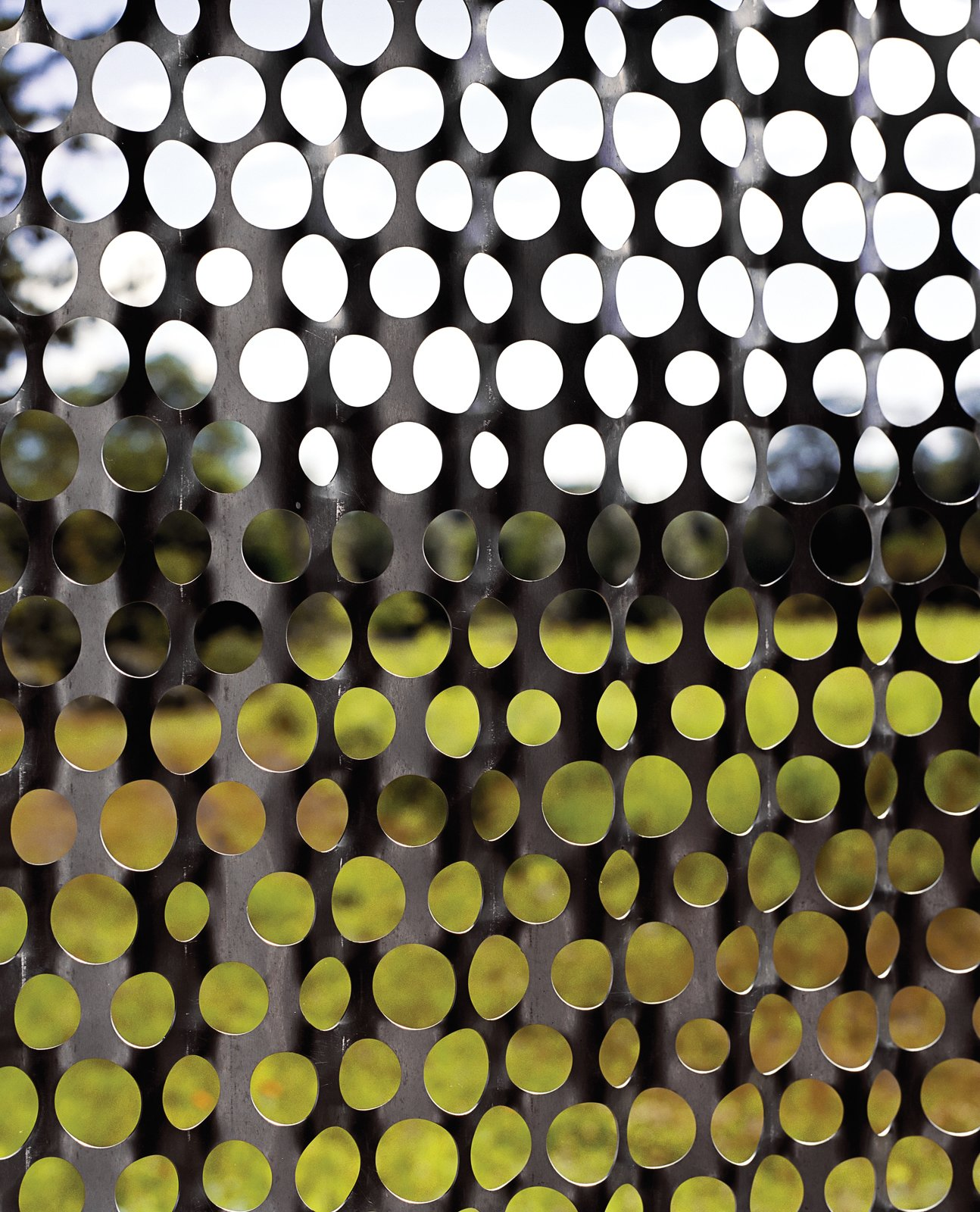 Outdoor and Metal Fences, Wall In the bathroom, perforated-metal screens create a pointillist perspective on the landscape.  Uses of Perforated Metal by William Lamb