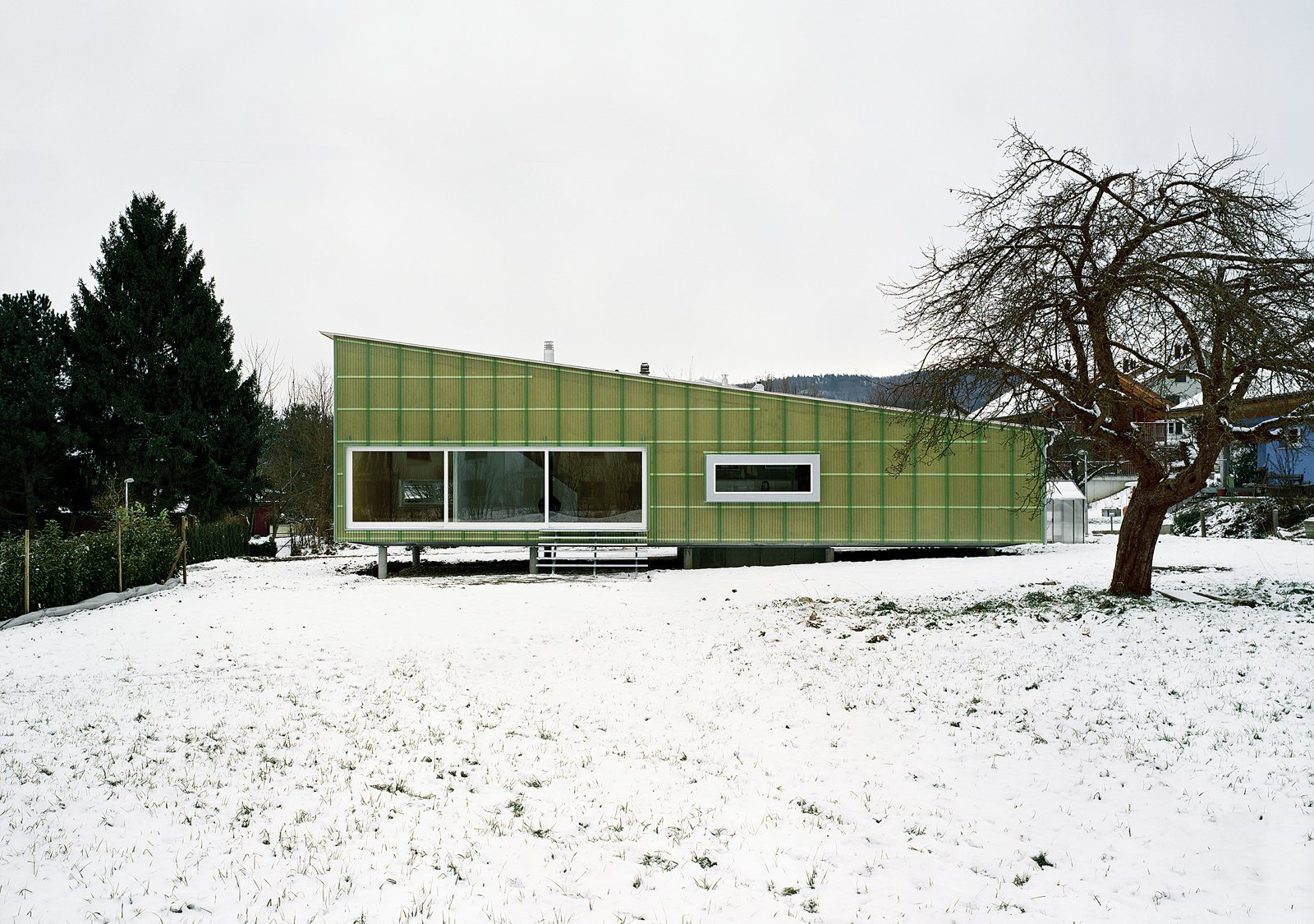 The entire house is made from slabs of prefabricated, formaldehyde-free compressed straw.  (Nearly) Net-Zero Homes by Erika Heet