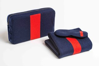 Parachute x Clare V. Travel Kit, $199 at parachutehome.com  Crafted from cozy 100% Merino wool, this design is a collaboration betweeen Parachute and Los Angeles-based designer Clare Vivier. Vivier's signature bold colors grace a blanket and eye mask whose carrying case doubles as a pillow.