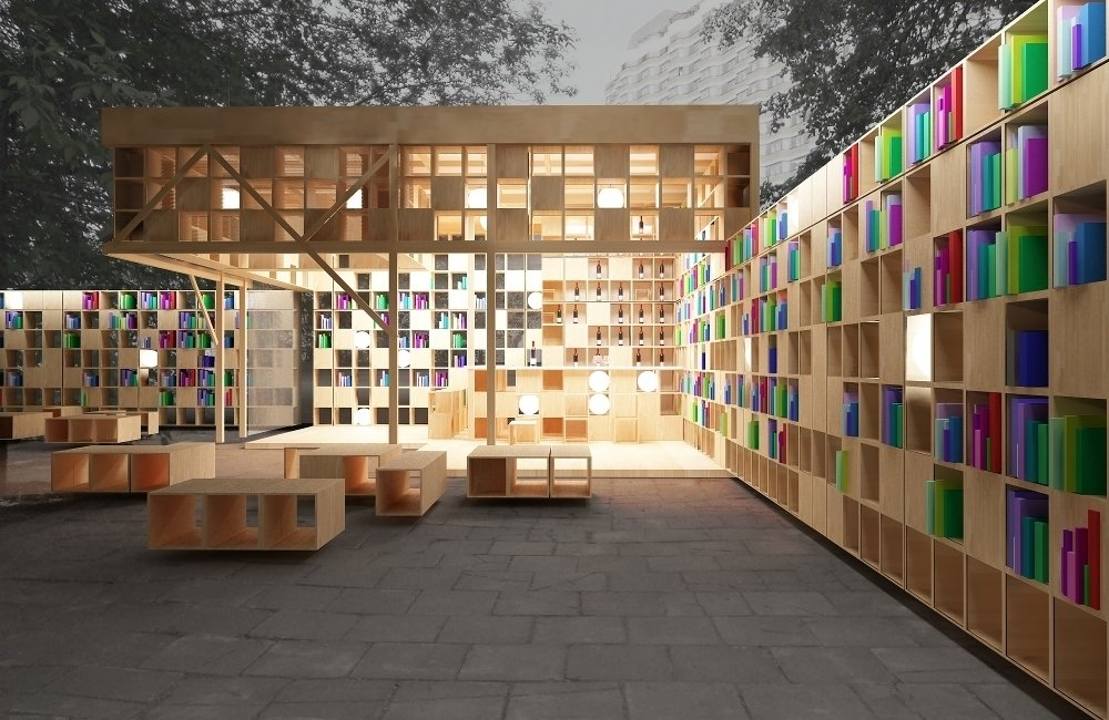 Constructed in Moscow's Park Muzeon for Archiwood and Office 17, the book pavilion accommodates those with larger libraries, offering walls of shelf space. Extending from the covered space of the pavilion, walls of shelving provide readers with privacy both in and out of doors. Photo courtesy of Ruetemple Architectural Studio.  Innovative Outdoor Libraries in Russia by Jacqueline Leahy