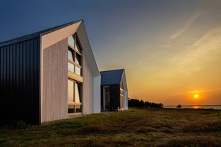 In the Acadian village of Caraquet, YH2 Architecture raised two identical cabins on a site 200 feet from the sandy shores of Chaleur Bay. The home is inhabited by a single family and used as a vacation spot.