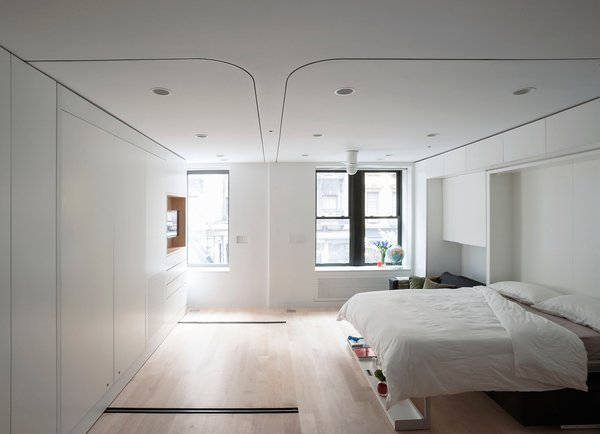 Modern Murphy beds cleverly marry form and function. This Murphy bed with couch also features a shelf at the foot of the bed that doubles as decor and handy storage. Here's the bed transitioned from day mode to sleep mode.