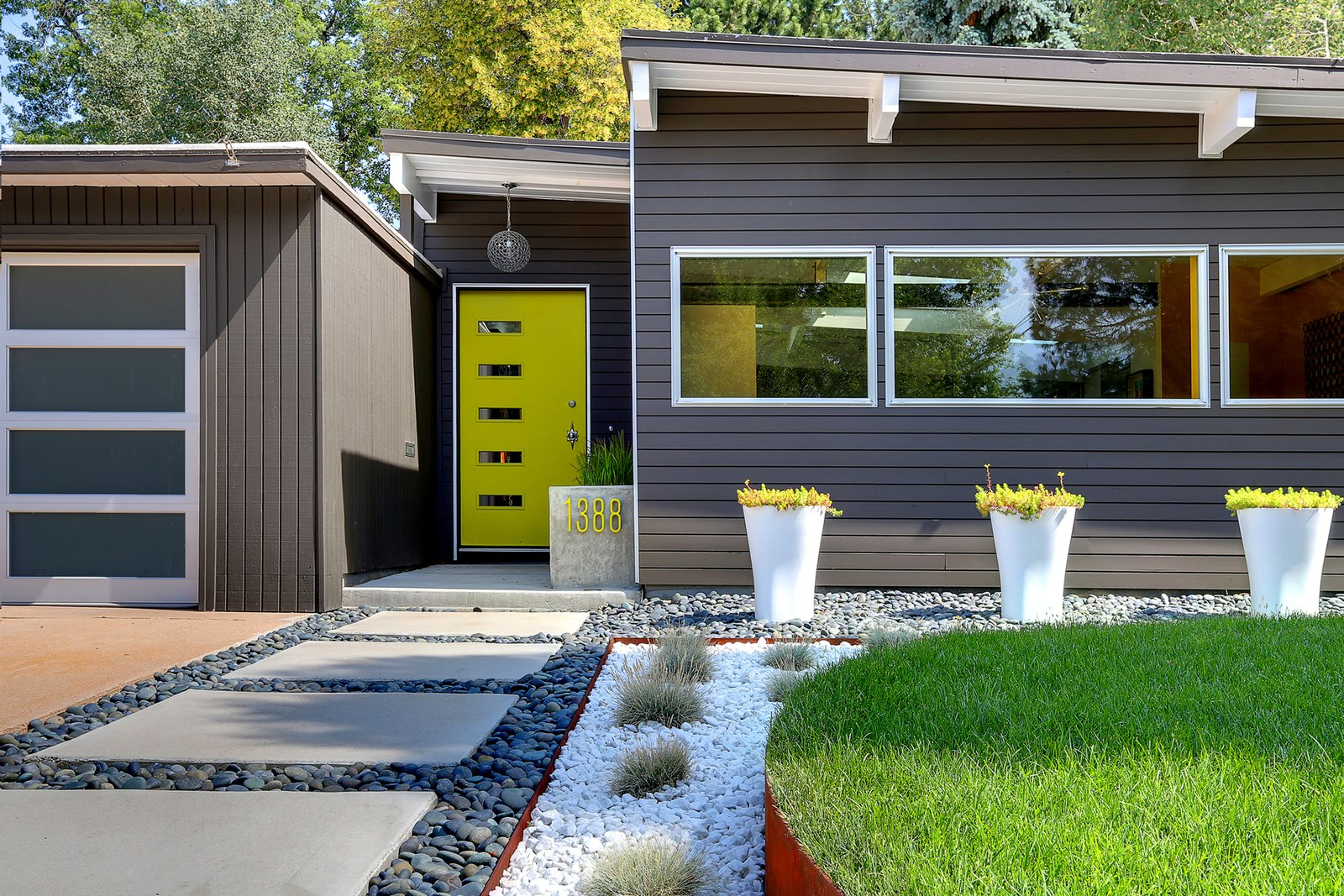 Neon-green sedum matches the front door. The design team also includes Courtney McRickard and Kyle Hebel; the contractor was Jesse Young of Landwise Colorado.  Modern Homes in Colorado by Luke Hopping from A Low-Maintenance Landscape for a Midcentury Denver Home
