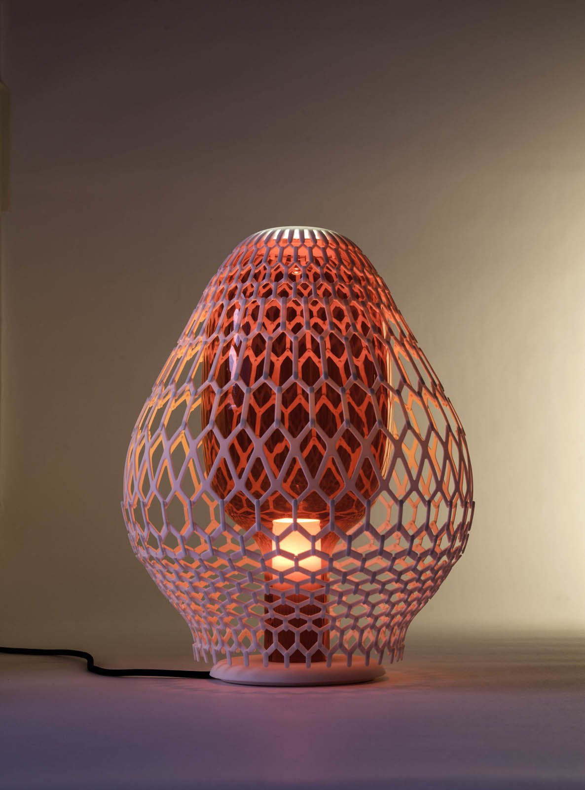When switched on, the lamp casts a colorful glow.  3D Printed Lighting by Exnovo by Diana Budds
